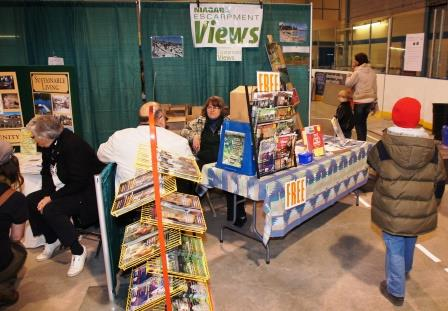 Talking to a visitor at the Niagara Escarpment Views booth.