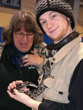 Getting close to a snake held by Ross Blackwood