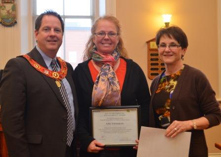 Kim Thomson is this year's recipient of the Town's Environmental Sustainability Award for an individual. Ms. Thomson was instrumental in starting a community garden at Princess Elizabeth Public School in 2013. She accepted the award from Mayor Rob Adams and Councillor Sylvia Bradley, chair of the Orangeville Sustainability Action Team.