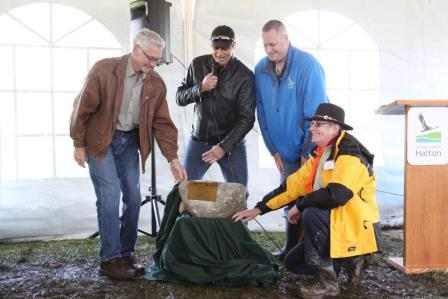 From left, Conservation Halton Chair John Vice, Halton Regional Chair Gary Carr, Conservation Halton CAO Ken Phillips and Deputy Area Commissioner for the Scouts Bob Collison unveil a commemorative plaque and rock which will remain on-site in recognition of the planting.