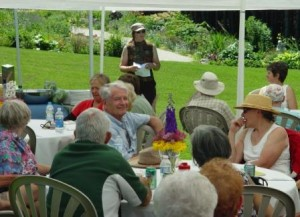 Lorraine Roberts welcoming guests to Delphinium Day.