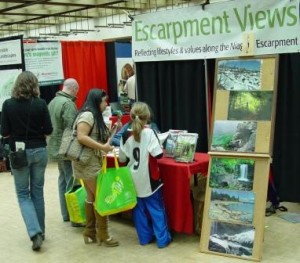People stop by Escarpment Views' booth at Guelph Organic Conference. Photo by Mike Davis