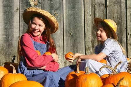 Page and Eva Milner help prepare for Pumpkin Sunday. Photo by Lisa Hunter.