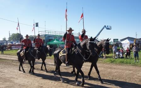 Four members of the RCMP carried flags in the parade.